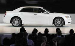 <p>A Chrysler 300 is driven on to the stage during the press day for the North American International Auto show in Detroit, Michigan January 10, 2011. REUTERS/Rebecca Cook</p>