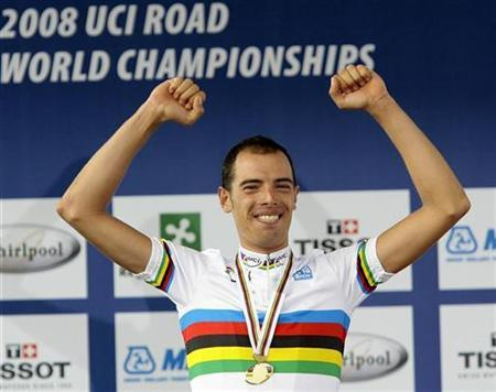 Italy's Alessandro Ballan celebrates on the podium after winning the men's road race at the world cycling championships in Varese September 28, 2008. REUTERS/Alessandro Garofalo (ITALY)