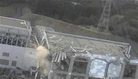 <p>An aerial view taken from a helicopter from Japan's Self-Defence Force shows damage to the No. 4 reactor at the Fukushima Daiichi nuclear power complex in this handout taken March 16, 2011 and released March 17, 2011. REUTERS/Tokyo Electric Power (TEPCO)/Handout</p>