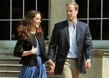 <p>Britain's Prince William and Catherine, Duchess of Cambridge, walk together in Buckingham Palace, following their wedding on Friday, in central London April 30, 2011. (ROYAL WEDDING) REUTERS/John Stillwell/Pool</p>