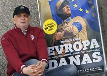 "<p>Haris Pasovic, director of the play ""Evropa Danas"" (Europe Today), poses next to a poster of the play in Sarajevo April 26, 2011. REUTERS/Danilo Krstanovic</p>"