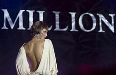 <p>A model presents a creation by design house Fresh Art at the opening night of the Millionaire Fair in Moscow November 27, 2008. Picture taken November 27, 2008. REUTERS/Thomas Peter</p>