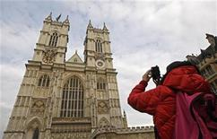 <p>A tourist photographs Westminster Abbey in London April 15, 2011. REUTERS/Luke MacGregor</p>