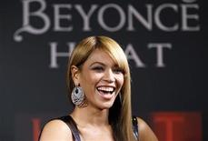 <p>Singer Beyonce smiles as she makes an appearance at the Macy's department store to promote her new fragrance Heat in New York February 3, 2010. REUTERS/Lucas Jackson</p>