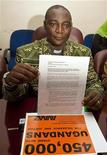 <p>Ugandan anti-gay activist Canon Gideon Byamugisha displays a copy of the petition rejecting homosexuality in Kampala March 1, 2010. REUTERS/James Akena</p>