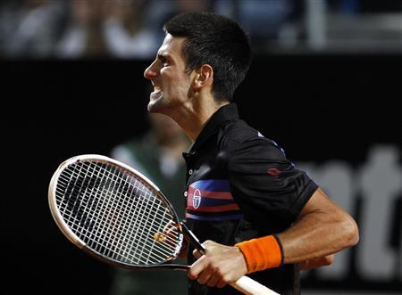 Novak Djokovic of Serbia celebrates after defeating Andy Murray of Britain in their semi-final match at the Rome Masters tennis tournament May 14, 2011. REUTERS/Giampiero Sposito