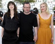 """<p>Director Lars Von Trier (C) poses with cast members Charlotte Gainsbourg (L) and Kirsten Dunst during a photocall for the film """"Melancholia"""", in competition at the 64th Cannes Film Festival, May 18, 2011. REUTERS/Jean-Paul Pelissier</p>"""