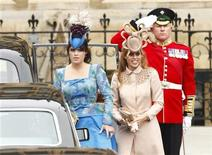 <p>Britain's Princess Eugenie (L) and Princess Beatrice arrive at Westminster Abbey before the wedding of Britain's Prince William and Kate Middleton, in central London April 29, 2011. REUTERS/Kai Pfaffenbach</p>