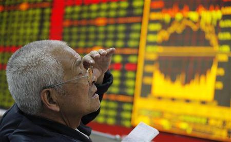 An investor reacts in front of an electronic board showing stock information at a brokerage house in Huaibei, Anhui province May 12, 2011. REUTERS/China Daily