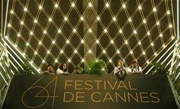 <p>Visitors stand on a balcony at the Festival Palace during the 64th Cannes Film Festival in Cannes, May 15, 2011. REUTERS/Christian Hartmann</p>