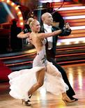 """<p>Kym Johnson and Hines Ward, one of the three remaining couples in the """"Dancing with the Stars"""" competition, dance in the final one-hour performance show in Los Angeles in this May 23, 2011 handout. The couple won the competition and the Mirror Ball trophy in the finale, which took place on Tuesday. REUTERS/Adam Taylor/ABC/© 2011 American Broadcasting Companies, Inc. All rights reserved/Handout</p>"""