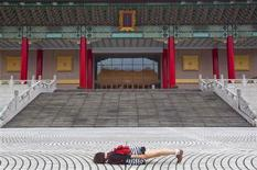 <p>Karren, part of the Pujie Girls, poses for a photograph while demonstrating planking during an interview with Reuters outside Taiwan's National Theatre in Taipei May 25, 2011. REUTERS/Nicky Loh</p>