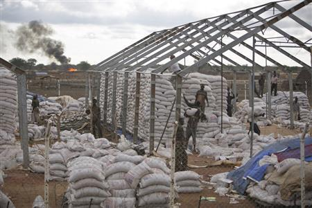 Men are pictured in a compound belonging to the World Food Programme as it was being looted in Abyei, in this United Nations Missions in Sudan (UNMIS) handout photo taken May 24, 2011 and released on May 25, 2011. REUTERS/Stuart Price/UNMIS/Handout