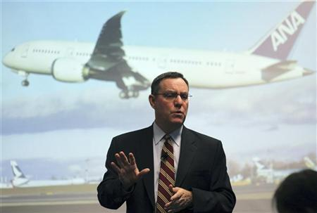 Scott Fancher, Boeing Vice President and 787 jetliner general manager, speaks in front of a projected photograph of an All Nippon Airways (ANA) 787 airplane while speaking to the media at the Future of Flight museum at Boeing's Commercial Airplane manufacturing facility in Everett, Washington February 14, 2011. REUTERS/Anthony Bolante