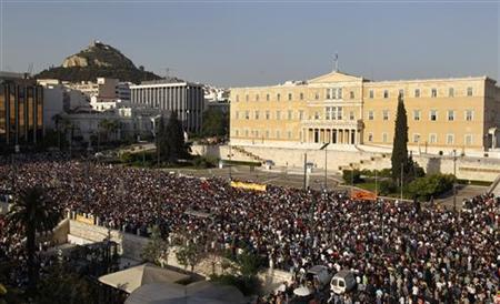 People gather in front of the parliament to protest against a new austerity package in Athens May 25, 2011. REUTERS/Yiorgos Karahalis