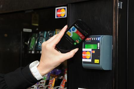 An undated handout photo shows Google Wallet being used to pay at a vending machine. REUTERS/Google/Handout