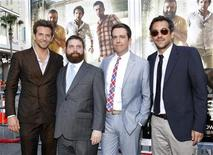 "<p>Director of the movie Todd Phillips (R) poses with cast members (from L-R) Bradley Cooper, Zach Galifianakis and Ed Helms at the premiere of ""The Hangover Part II"" at Grauman's Chinese theatre in Hollywood, California May 19, 2011. The movie opens in the U.S. on May 26. REUTERS/Mario Anzuoni</p>"