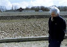 <p>Former prisoner and famous Spanish author Jorge Semprun walks past the main gate of the Nazi concentration camp Buchenwald April 8, 1995. Semprun has died at the age of 87. REUTERS/STR New</p>