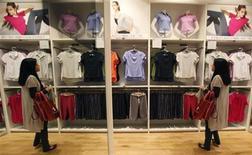 <p>A woman looks at shirts displayed at a casual clothing store in Tokyo May 31, 2011. REUTERS/Yuriko Nakao</p>