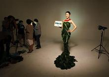 <p>Chinese movie star Gao Yuanyuan poses in a gown made of lettuce and cabbage leaves during an event organized by People for the Ethical Treatment of Animals (PETA) Asia in Beijing, in this file photo taken June 8, 2011. REUTERS/Petar Kujundzic/Files</p>