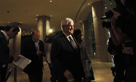 Republican U.S. presidential candidate Newt Gingrich (C) leaves after speaking at a Republican Jewish Coalition event in Beverly Hills, California June 12, 2011. REUTERS/Mario Anzuoni
