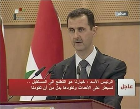 Syria's President Bashar al-Assad speaks in Damascus in this still image taken from video June 20, 2011.REUTERS/Syrian TV via Reuters TV