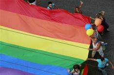 <p>Participants take part in a gay parade in central Athens June 13, 2009. REUTERS/John Kolesidis</p>