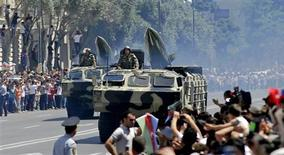 <p>Military vehicles take part in a parade held in the Azeri capital Baku June 26, 2011. REUTERS/Stringer</p>
