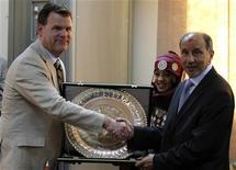 <p>Canada's Foreign Minister John Baird (L) exchanges gifts with the head of Libya's National Transitional Council Mustafa Abdel Jalil, during his first visit to the rebel-held city of Benghazi June 27, 2011. REUTERS/Mohamed Abd El-Ghany</p>