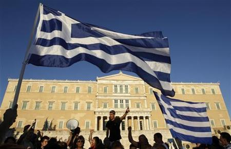 Protesters shout slogans during a rally against the austerity economic measures and corruption in front of the parliament at Syntagma (Constitution) square in Athens June 26, 2011. REUTERS/John Kolesidis
