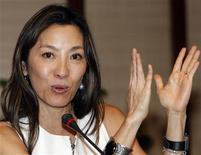 """<p>Malaysian actress Michelle Yeoh, global ambassador for the """"Make Roads Safe"""" campaign, gestures during a news conference on Pathways to Sustainable Transport forum at the Asian Development Bank (ADB) in Mandaluyong City, Metro Manila May 26, 2010. REUTERS/Cheryl Ravelo</p>"""