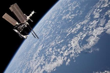 The International Space Station is seen with the docked space shuttle Endeavour in this photo provided by NASA and taken May 23, 2011. REUTERS/NASA/Handout