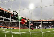 <p>Gaetane Thiney of France scores a goal against Canada during their Women's World Cup Group A soccer match in Bochum June 30, 2011. REUTERS/Ina Fassbender</p>