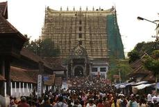<p>Devotees throng to Sree Padmanabhaswamy temple after offering prayers on the eve of Pongala festival in Thiruvananthapuram, capital of the southern Indian state of Kerala February 18, 2011. A treasure trove of gold, diamonds and precious stones hidden for centuries was discovered in the underground vaults of the temple, a temple official said on Sunday, as authorities scrambled armed police to guard the shrine. Local media said that the search team's finds included a four-feet-tall gold statue studded with emeralds, 15-feet-long gold necklaces and jewel-encrusted crowns. The estimated value of the hoard is 750 billion rupees ($17 billion), but officials said they were yet to assess the findings. Picture taken February 18, 2011. REUTERS/Sivaram V</p>