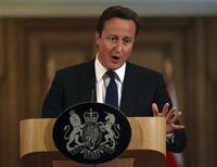 <p>Britain's Prime Minister David Cameron speaks during a news conference at number 10 Downing Street in London July 8, 2011. Cameron said on Friday he believed that his former communications chief Andy Coulson was being investigated over allegations of phone hacking during his time as editor of the News of the World. REUTERS/Peter Macdiarmid/pool</p>