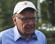 <p>Rupert Murdoch, Australian-American media mogul and the chairman and chief executive of News Corporation, arrives at the Sun Valley Inn before the start of the second day of the Allen and Company Sun Valley Conference in Sun Valley, Idaho July 7, 2011. REUTERS/Anthony Bolante</p>