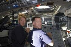 <p>Space shuttle Atlantis Commander Chris Ferguson (R) and mission specialist Sandy Magnus are pictured on the aft flight deck of the orbiter during the mission's second day of activities in Earth orbit in this photo provided by NASA and taken July 9, 2011. REUTERS/NASA/Handout</p>