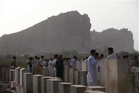 Members of the Ahmadi Muslim community await to bury victims at a graveyard in Chenab Nagar, located in Punjab's Chiniot District, Pakistan May 29, 2010. Chenab Nagar, also known as Rabwah, is the headquarters for the Ahmadiyya community in Pakistan. REUTERS/Stringer