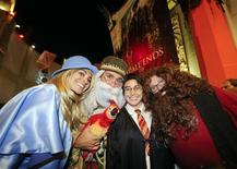 "<p>(L-R) Alicia Limon, Scott Johnson, Danny Conn and Vanessa Limon, dressed up as their favorite characters, join the crowds line up to be the first to see the new Harry Potter movie ""Harry Potter and the Deathly Hallows - Part 2"" at a minute after midnight in the Hollywood area of Los Angeles, California July 14, 2011. REUTERS/Gus Ruelas</p>"