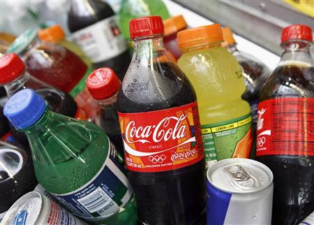 A Coca-Cola bottle is seen with other beverages in New York in this June 23, 2008 file photo. U.S. beverage companies are stepping up their efforts against anti-obesity campaigns, targeting local governments across the country with voluminous document requests and suing New York City's public health department. Picture taken June 23, 2008. REUTERS/Shannon Stapleton/Files
