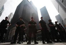 <p>Police officers stand on guard during the G20 summit in Toronto June 27, 2010. REUTERS/Mark Blinch</p>