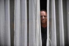 <p>U.S. writer Dennis Lehane poses during the XXIV Semana Negra (Noir Week) book fair in the northern Spanish town of Gijon July 28, 2011. REUTERS/Eloy Alonso</p>