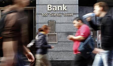 People walk past a bank on Grafton Street in Dublin March 31, 2011. REUTERS/Cathal McNaughton