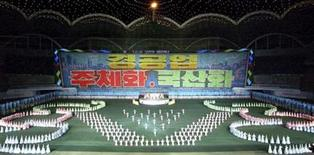 """<p>North Koreans perform during the Arirang Mass Games at the May Day Stadium in Pyongyang August 1, 2011 in this picture released August 2, 2011 by North Korea's official KCNA news agency. The characters read: """"Light industry. (North Korea's) Juche Idea. Localization."""" REUTERS/KCNA</p>"""