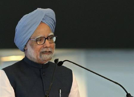 India's Prime Minister Manmohan Singh speaks during the inauguration ceremony of the newly constructed Terminal 3 at Indira Gandhi International Airport in New Delhi July 3, 2010. REUTERS/B Mathur/Files