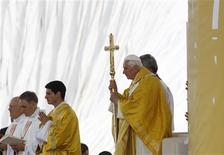 <p>Pope Benedict XVI (R) leads a mass at the Cuatro Vientos aerodrome as part of World Youth Day festivities in Madrid August 21, 2011. REUTERS/Susana Vera</p>