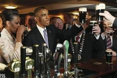 <p>U.S. President Barack Obama stands with first lady Michelle Obama as he toasts with his pint of Guinness in Ollie Hayes Pub in Obama's ancestral home in Moneygall May 23, 2011. REUTERS/Maxwell's/Pool</p>