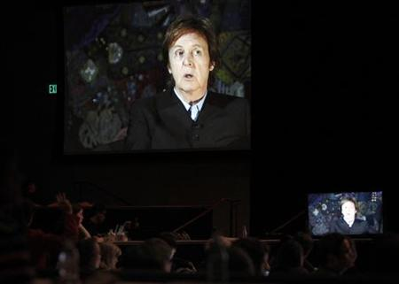 British singer Paul McCartney answers a question via satellite during the Showtime session for ''The Love We Make'' during the 2011 Summer Television Critics Association Cable Press Tour in Beverly Hills, California August 4, 2011. REUTERS/Mario Anzuoni