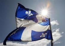 <p>A Quebec flag flaps in the sky during the Moulin a Parole, a 24-hour long series of public readings, on the Plains of Abraham in Quebec City, September 13, 2009. REUTERS/Mathieu Belanger</p>