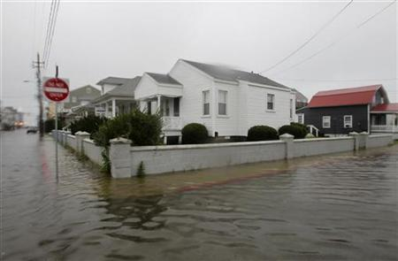 Flood waters caused by Hurricane Irene raise on a residential street in Ocean City, Maryland, August 27, 2011. REUTERS/Molly Riley